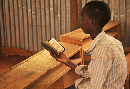 dadaab: DADAAB, SOMALIA - AUGUST 7  A primitive Africans unidentified child in the class who read the Qur
