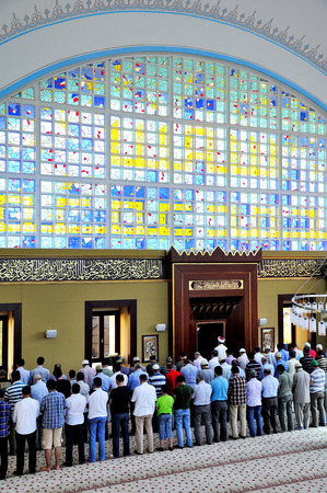 ISTANBUL, TURKEY - JULY 04  Muslims who pray istoc new mosque on July 04, 2012 in Istanbul, Turkey  Istoc new mosque in the last 30 years one of the mosques in modern style