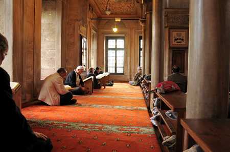 ISTANBUL, TURKEY - APRIL 17  Eyup Sultan mosque after prayers at the Muslims who read the Quran, 17 April 2010 in Istanbul Turkey  Eyup mosque was built in 1458 and the mosque of Istanbul is the most visited