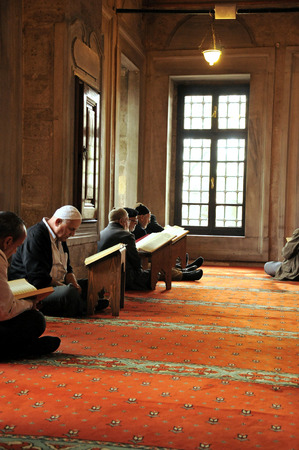 establishing: ISTANBUL, TURKEY - APRIL 17  Eyup Sultan mosque after prayers at the Muslims who read the Quran, 17 April 2010 in Istanbul Turkey  Eyup mosque was built in 1458 and the mosque of Istanbul is the most visited