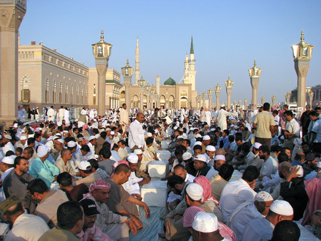 civilizing: MEDINA, SAUDI ARABIA  KSA  - OCTOBER 8  Muslims get ready to pray around Nabawi Mosque October 8, 2007 in Medina, KSA  Muslims from all over the world visit this place would do