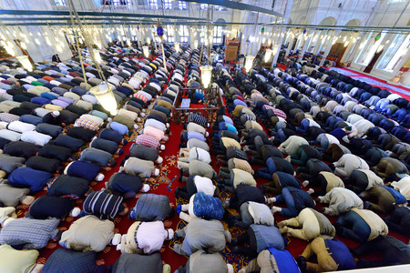 muslim prayer: ISTANBUL, TURKEY - MAY 17  noon prayer in congregation male Muslims Fatih Mosque on May 17, 2014 in Istanbul, Turkey  Soma for mine workers who died in the memorial program