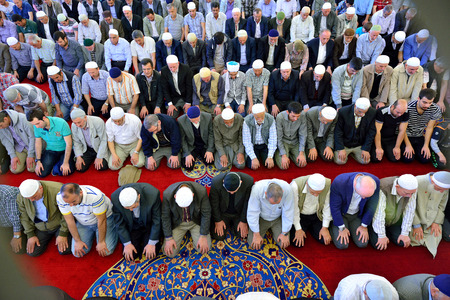 skullcap: ISTANBUL, TURKEY - MAY 17  noon prayer in congregation male Muslims Fatih Mosque on May 17, 2014 in Istanbul, Turkey  Soma for mine workers who died in the memorial program