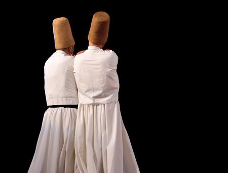 civilizing: ISTANBUL, TURKEY - DECEMBER 14  Sufi whirling dervish  Semazen  dances, Commemoration of Mevlana Jalaluddin Rumi on December 14, 2013 in Istanbul  Semazen conveys God