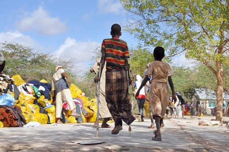 DADAAB, SOMALIA-AUGUST 07: Dadaab refugee camp to get help from crutches young Dadaab, Somalia on August 7, 2011. Thousands of Somali immigrant camp