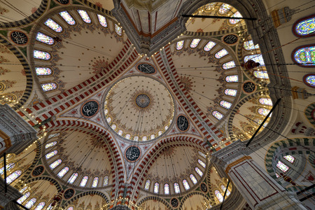 conqueror: ISTANBUL, TURKEY - DEC 14: Dome of the mosque in conqueror photo taken with a wide angle on December 14, 2014 in Istanbul, Turkey. he construction of the mosque began in 1462 and was completed in 1470.