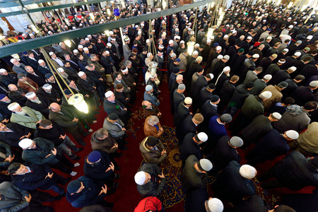 skullcap: ISTANBUL, TURKEY - DEC 14: noon prayer in congregation male Muslims Fatih Mosque on December 14, 2014 in Istanbul, Turkey. Muslim Prayer is a prayer to the hair they do 5 times a day.