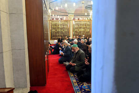 congregation: ISTANBUL, TURKEY - DEC 14: noon prayer in congregation male Muslims Fatih Mosque on December 14, 2014 in Istanbul, Turkey. Muslim Prayer is a prayer to the hair they do 5 times a day.