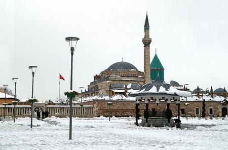 philosophers: KONYA, TURKEY- NOVEMBER 26, 2014: Mevlana museum and sufi center in Konya, Turkey on November 26, 2014. Tomb of Mevlana, the founder of Mevlevi sufi dervish order, with prominent green tower in Konya.