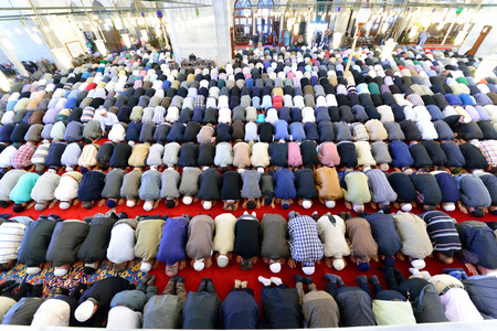 congregation: ISTANBUL, TURKEY - MAY 17: noon prayer in congregation male Muslims Fatih Mosque on May 17, 2014 in Istanbul, Turkey. Prayer is a prayer that Muslims do five times each day. Editorial