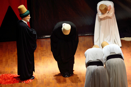 civilizing: ISTANBUL, TURKEY - DECEMBER 20: Whirling dervish ceremony of greeting each other , Commemoration of Mevlana Jalaluddin Rumi on December 20, 2014 in Istanbul. Semazen conveys God