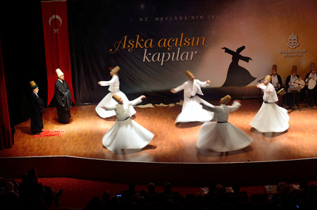 ISTANBUL, TURKEY - DECEMBER 20: Sufi whirling dervish (Semazen) dances, Commemoration of Mevlana Jalaluddin Rumi on December 20, 2014 in Istanbul. Semazen conveys God