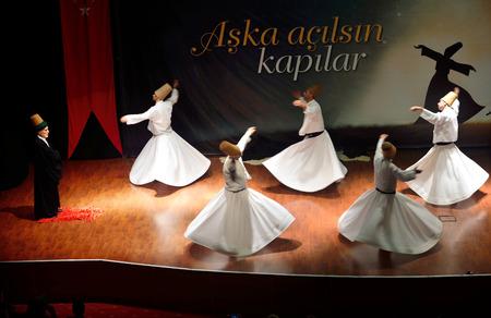 civilizing: ISTANBUL, TURKEY - DECEMBER 20: Sufi whirling dervish (Semazen) dances, Commemoration of Mevlana Jalaluddin Rumi on December 20, 2014 in Istanbul. Semazen conveys God