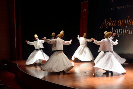 sufi: ISTANBUL, TURKEY - DECEMBER 20: Sufi whirling dervish (Semazen) dances, Commemoration of Mevlana Jalaluddin Rumi on December 20, 2014 in Istanbul. Semazen conveys God
