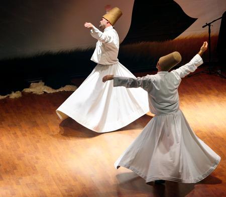 ISTANBUL, TURKEY - DECEMBER 20: Sufi whirling dervish (Semazen) dances, Commemoration of Mevlana Jalaluddin Rumi on December 20, 2014 in Istanbul. Semazen conveys God