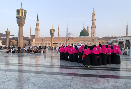 MEDINA, KINGDOM OF SAUDI ARABIA (KSA) - JAN 30: Pilgrims pray outside Masjid Nabawi after morning prayer Jan 30, 2015 in Medina, KSA. Underneath the green dome where Prophet Muhammad is laid to rest. Editorial