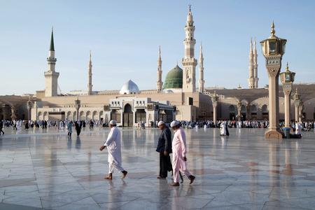 worshiped: MEDINA, KINGDOM OF SAUDI ARABIA (KSA) - JAN 31: Muslims marching in front of the mosque of the Prophet Muhammad on January 31, 2015 in Medina, KSA. Prophet