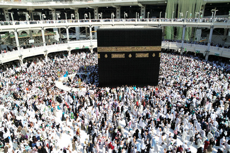 MECCA, SAUDI ARABIA - FEBRUARY 2: Muslim pilgrims, from all around the World, revolving around the Kaaba on February 2, 2015 in Mecca, Saudi Arabia. Muslim people praying together at holy place. Editorial