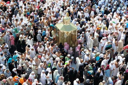 assume: MECCA, SAUDI ARABIA - FEBRUARY 2: Muslims look into Maqam Ibrahim (the station of Ibrahim) February 2, 2015 in Makkah, Saudi Arabia. Inside the Maqam Ibrahim is a stone block where Ibrahim stood to build the kaaba. Editorial