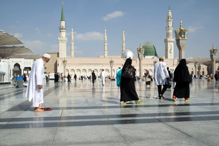 ksa: MEDINA, KINGDOM OF SAUDI ARABIA (KSA) - JAN 30: Muslims walking in the courtyard of the mosque of the Prophet on January 30, 2015 in Medina, KSA. Prophet