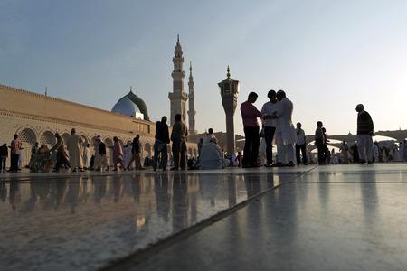 MEDINA, KINGDOM OF SAUDI ARABIA (KSA) - JAN 30: Muslims marching in front of the mosque of the Prophet Muhammad on January 30, 2015 in Medina, KSA. Prophet