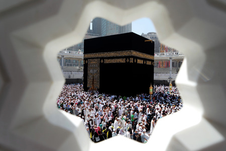 assume: MECCA, SAUDI ARABIA - FEBRUARY 4: Muslim pilgrims, from all around the World, revolving around the Kaaba on February 4, 2015 in Mecca, Saudi Arabia. Muslim people praying together at holy place.