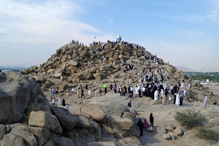 MECCA, SAUDI ARABIA - FEB 3: Muslims at Mount Arafat (or Jabal Rahmah) February 3, 2015 in Arafat, Saudi Arabia. This is the place where Adam and Eve met after being overthrown from heaven. Stock Photo - 37712491