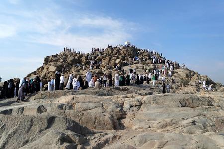 adam and eve: MECCA, SAUDI ARABIA - FEB 3: Muslims at Mount Arafat (or Jabal Rahmah) February 3, 2015 in Arafat, Saudi Arabia. This is the place where Adam and Eve met after being overthrown from heaven.