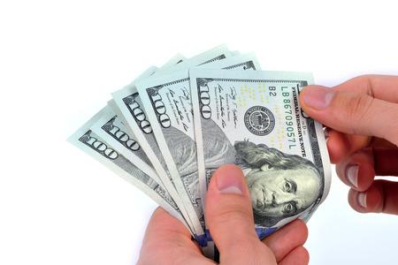 one hundred dollars: One hundred dollars banknotes isolated on white background