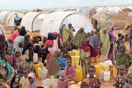 dadaab: DADAAB SOMALIA  AUGUST 06: Refugee camp hundreds of thousands of difficult conditions Somali immigrants are staying. African people waiting to get in the water. August 06 2011 in Dadaab Somalia.