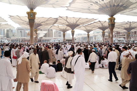 worshiped: MEDINA KINGDOM OF SAUDI ARABIA KSA  JAN 30: After Friday prayers Muslims gathered in front of the mosque of the prophet on January 30 2015 in Medina KSA. Prophets tomb is under the green dome.