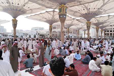 ksa: MEDINA SAUDI ARABIA KSA  JAN 30: After Friday prayers Muslims gathered in front of the mosque of the prophet on January 30 2015 in Medina KSA. Nabawi Mosque is the second holiest mosque in Islam and here is Prophet Muhammad is laid to rest. Editorial