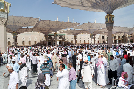 worshiped: MEDINA SAUDI ARABIA KSA  JAN 30: After Friday prayers Muslims gathered in front of the mosque of the prophet on January 30 2015 in Medina KSA. Nabawi Mosque is the second holiest mosque in Islam and here is Prophet Muhammad is laid to rest. Editorial