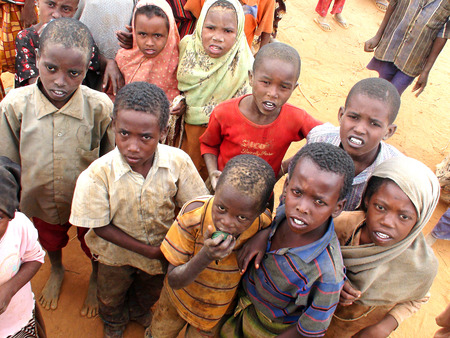 somalis: DADAAB, SOMALIA-AUGUST 07: Desperately waiting african children at the Dadaab refugee camp where thousands of Somalian wait for help because of hunger on August 07, 2011, in Dadaab, Somalia.