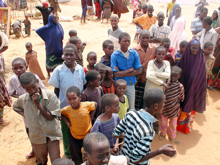 somalian: DADAAB, SOMALIA-AUGUST 07: Pending desperate people at the Dadaab refugee camp where thousands of Somalian wait for help because of hunger on August 07, 2011, in Dadaab, Somalia.