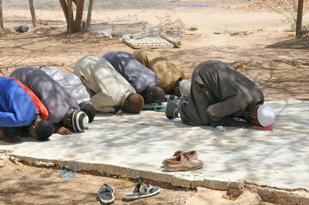 dadaab: DADAAB, SOMALIA-AUGUST 08: Muslims praying in Dadaab refugee camp. Hundreds of thousands of refugees in the camp that is located in the tent August 08, 2011, in Dadaab, Somalia. Editorial