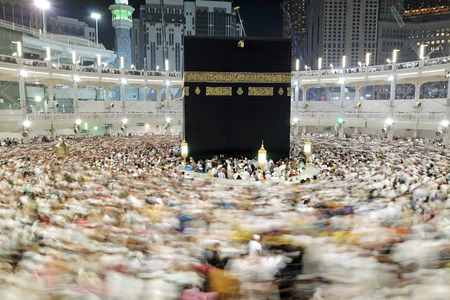 assume: MECCA, SAUDI ARABIA - FEBRUARY 2: Muslim pilgrims, from all around the World, revolving around the Kaaba on February 2, 2015 in Mecca, Saudi Arabia. Muslim people praying together at holy place. Editorial