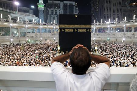 praying together: MECCA, SAUDI ARABIA - FEBRUARY 2: Muslim pilgrims, from all around the World, revolving around the Kaaba on February 2, 2015 in Mecca, Saudi Arabia. Muslim people praying together at holy place. Editorial