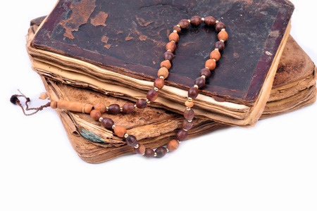 islamic prayer: An ancient hand scripted Quran with prayer beads