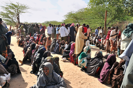 DADAAB, SOMALIA - AUGUST 7: Unidentified women and men live in the Dadaab refugee camp hundreds of thousands of Somalis wait for help because of hunger on August 7, 2011 in Dadaab, Somalia. Editorial