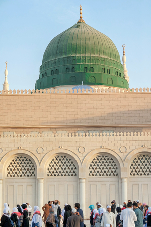 worshiped: MEDINA, KINGDOM OF SAUDI ARABIA KSA - JAN 30: Muslims marching in front of the mosque of the Prophet Muhammad on January 31, 2015 in Medina, KSA. Prophets tomb is under the green dome.