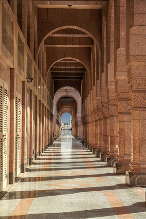 worshiped: MEDINA, SAUDI ARABIA KSA - JANUARY 30: Arches of ancient porch behind the mosque and tomb of the prophet January 30, 2015 in Medina, KSA.