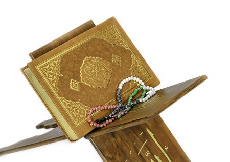 lectern: Holy Islamic book Koran Quran closed with rosary Stock Photo