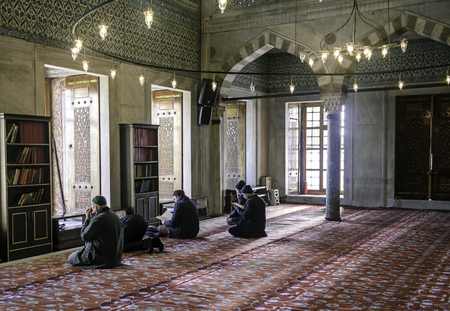 mehmet: ISTANBUL, TURKEY - JANUARY 01: Muslims preparing during the prayer Sultanahmet Mosque on January 01, 2016 in Istanbul, Turkey. Blue Mosque, built in the 17th century by the architect Mehmet Aga.