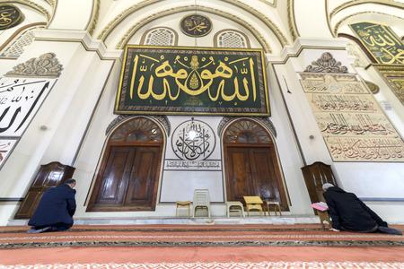 skullcap: BURSA, TURKEY - JANUARY 13: An interior view of Great Mosque Ulu Cami on January 13, 2016 in Bursa, Turkey. Great Mosque is the largest mosque in Bursa. Muslims who pray in the mosque. Editorial