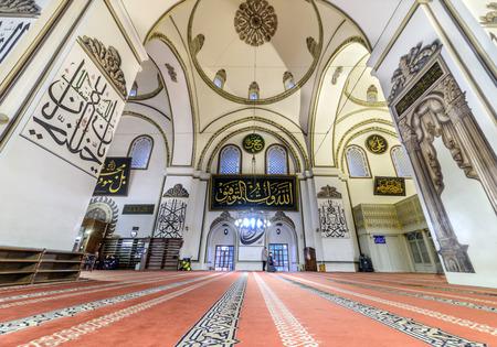 skullcap: BURSA, TURKEY - JANUARY 13: An interior view of Grand Mosque Ulu Cami on January 13, 2016 in Bursa, Turkey. Great Mosque is the largest mosque in Bursa. Muslims who pray in the mosque. Editorial