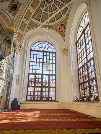 konya: KONYA, TURKEY - FEBRUARY 10: An unidentified muslim man prays Aziziye Mosque on February 10, 2016 in Konya, Turkey. The mosque built by Sultan Abdulazizs mother Hatun Pertevniyal was opened in 1874.