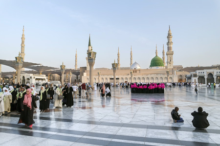 worshiped: MEDINA, KINGDOM OF SAUDI ARABIA (KSA) - JAN 30: Pilgrims pray outside Masjid Nabawi after morning prayer Jan 30, 2015 in Medina, KSA. Underneath the green dome where Prophet Muhammad is laid to rest. Editorial