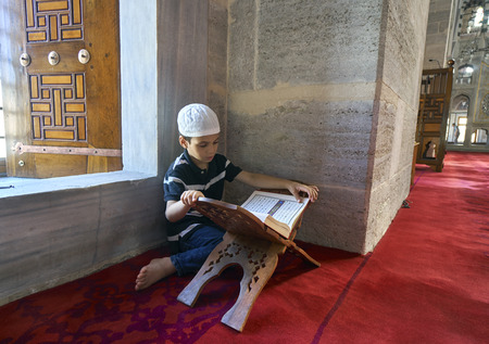 lectern: ISTANBUL, TURKEY - JULY 1: Edirnekap? Mihrimah Sultan Mosque in reading Koran child, 1 July 2016 in Istanbul Turkey. The Muslims who have made a tradition of reading Koran the month of Ramadan.