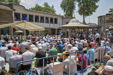 civilizing: ISTANBUL, TURKEY - JULY 1: Eyup Sultan mosque muslims who pray, 1 July 2016 in Istanbul Turkey. Eyup mosque was built in 1458 and the mosque of Istanbul is the most visited.
